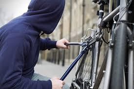 Thief Stealing A Bike